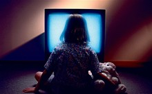 kid in front of television
