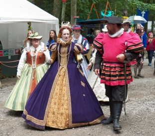 The queen mingles amongst the peasant folk