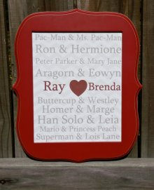 This famous couples framed 8x10 wall art comes with a snazzy red frame ready to hang on your favorite geek's wall. Nine famous couples that are SO in love are listed along with the geeks' names on a light gray chevron background. It is printed on card stock and shipped with the wooden frame (glass is not included).   The couples include: Pac-Man & Ms. Pac-Man, Ron & Hermione, Peter Parker & Mary Jane, Aragorn & Eowyn, Buttercup & Westley, Homer & Marge, Han Solo & Leia, Mario & Princess Peach, Superman & Lois Lane.